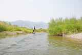 Fly fisherman fishing in river of Montana state