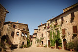 Main square of the medieval village Montemerano in summer. Tuscany, Italy - 174471722
