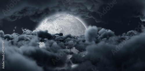 Shining moon hide by dark grey clouds in the sky