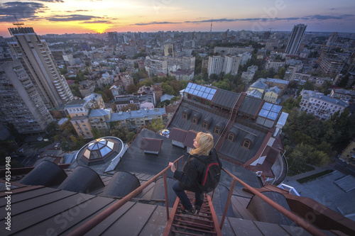 Woman standing on the roof on the modern building in Kiev, Ukraine