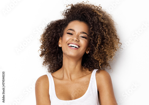Beautiful african american girl with an afro hairstyle smiling - 174544330