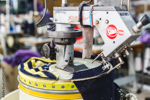 Professional equipment for tailoring in the factory. Overlock on clothes.