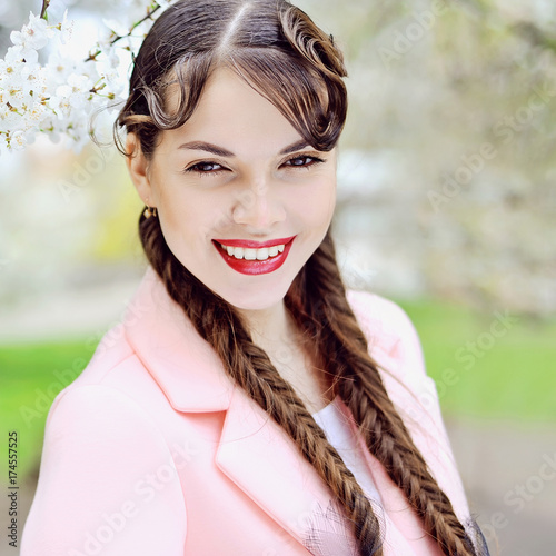 Spring portrait of beauty girl with pigtails