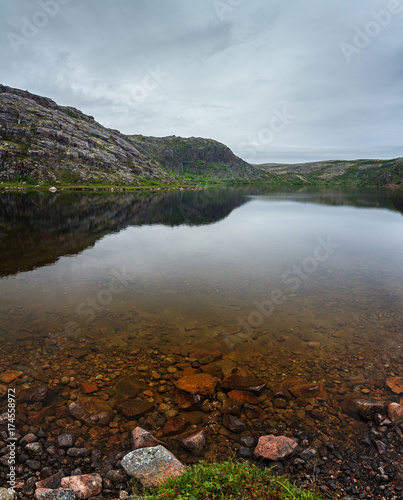 Fotobehang Chocoladebruin Lake with clean, fresh water on the shore of the Barents sea. Kola Peninsula , Russia.
