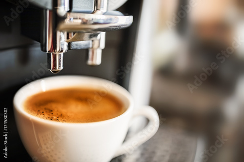 Espresso machine making fresh coffee - 174580302