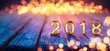 2018 - Happy New Year - Golden Numbers On Defocused Table And Bokeh Lights  - 174612106