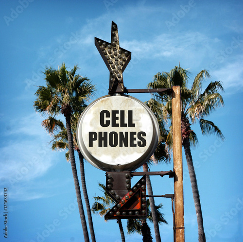 aged and worn cell phones sign with palm trees