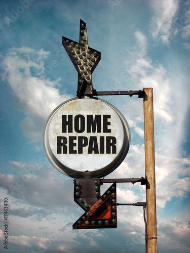 aged and worn vintage home repair sign