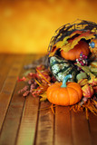 Pumpkins, gourds, and leaves in an Autumn cornucopia background - 174638916