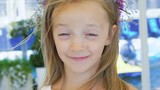 Close-up portrait of a happy little girl bursting in laugh. Slowly - 174639191