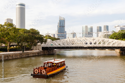 Boat Approaching Anderson Bridge on Singapore River Poster