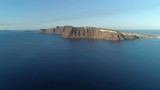 Flying towards Thirasia Island on Aegean Sea ,Santorini, Greece. Caldera view in morning light - 174645170
