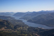 Aerial landscape view of the Inlet that leads from the Ocean to Port Alberni in Vancouver Island, British Columbia, Canada. Taken during a sunny summer day.