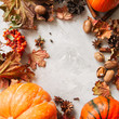 Autumn season background. Pumpkins, maple leaves and spices.