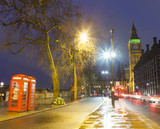 London city at night with Big Ben and telephone cabin