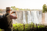 Photographer using smart phone at Victoria Falls - 174676149