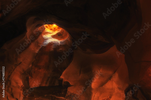 Fotobehang Bruin image of beautiful golden light through the cave entrance