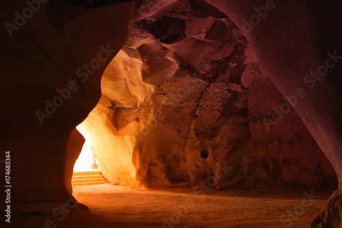 Fotobehang Rood paars image of beautiful golden light through the cave entrance
