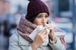 Woman coughing in winter