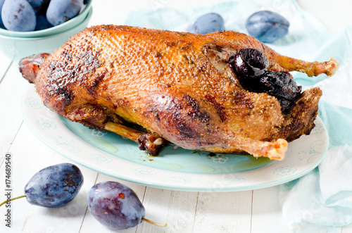 Christmas duck baked with plums - 174689540