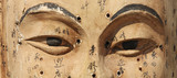 Ancient wooden face showing acupuncture points  - 174694523