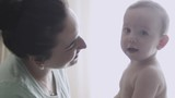 Mother kissing her child slow motion - 174699516