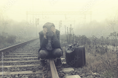 desperate person waits for the train to leave Poster