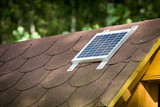 Small photovoltaic battery on bower roof, alternative energy. - 174716708