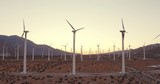 Aerial View Wind Turbines Spinning At Sunset, Clean Sustainable Renewable Energy - 174721102