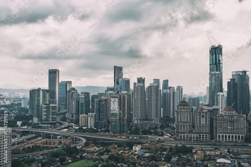 Cityscape with cloudy sky and scyscrapers Poster