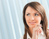 Portrait of thinking businesswoman at office - 174732370