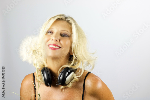 Plakát blond woman smiling looking big dandelion