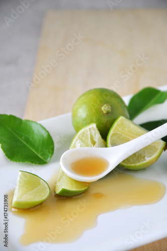 Honey on Spoon with Fresh Lime Poster