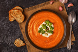 Pumpkin and carrot soup with cream, seeds and parsley. - 174737335