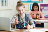 Portrait Of Female Pupil In Science Lesson Studying Robotics - 174746511