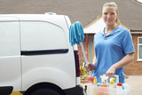 Portrait Of Young Woman Running Mobile Cleaning Business With Van