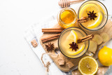 Hot Ginger tea with lemon, honey and spices. Top view with copy space on white. - 174747749