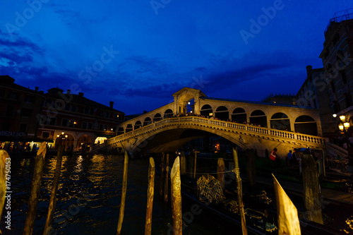 Deurstickers Amsterdam At the evening around the Grand Canal, The Rialto bridge under evening lights.