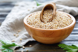 Pearl barley and a scoop in wooden bowl. - 174756700
