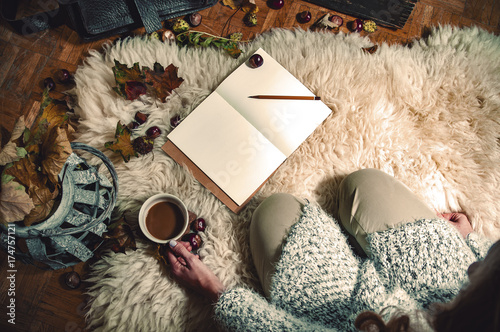 In de dag Herfst Relaxing autumn day at home with coffee and blank notebook for copyspace in warm coziness scandinavian hygge style, POV first person look which is female