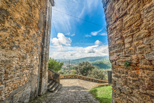 Fotobehang Toscane Rustic walls with Montecatini landscape on the background