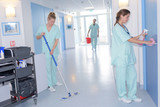 cleaner with mop and uniform cleaning hospitals corridor - 174762903