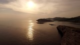 Aerial view of sunset over Adriatic sea in Croatia with seagulls flying around - 174775596