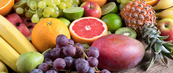 Fresh fruits background. Healthy eating concept. Panorama.
