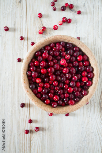 fresh cranberries on white wooden surface - 174804314
