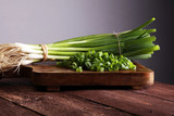 Spring onions are rich in vitamins,minerals and natural compound. Green onions or Spring onions on wooden board cutting. - 174806551