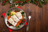 Christmas fish. Roasted cod pieces, served in vegetable sauce. - 174807964