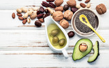 Selection food sources of omega 3 and unsaturated fats. Superfood high vitamin e and dietary fiber for healthy food. Almond ,pecan,hazelnuts,walnuts and olive oil on stone background. - 174809163