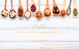 Selection food sources of omega 3 and unsaturated fats. Superfood high vitamin e and dietary fiber for healthy food. Mixed nuts almond ,pecan,hazelnuts,walnuts and various beans on white background. - 174809346