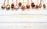 Selection food sources of omega 3 and unsaturated fats. Superfood high vitamin e and dietary fiber for healthy food. Mixed nuts almond ,pecan,hazelnuts,walnuts and various beans on white background. - 174809399